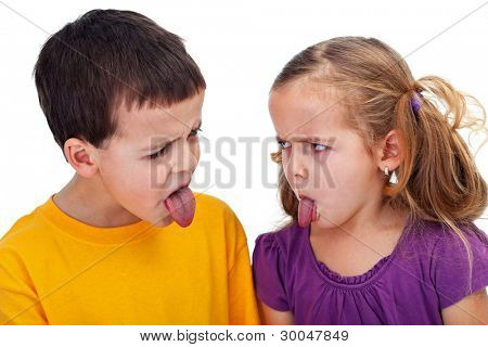 Kids with bad behavior - mocking each other with tongues sticking out, closeup