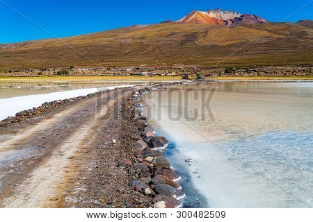 View Of The Dormant Volcano Tunupa The Village Of Coqueza And The Uyuni Salt Flat In Bolivia