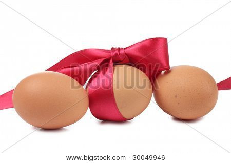Color photo of eggs and red bow