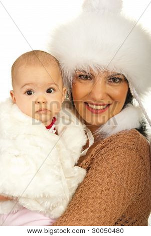 Mother And Baby Girl In Fur Clothes