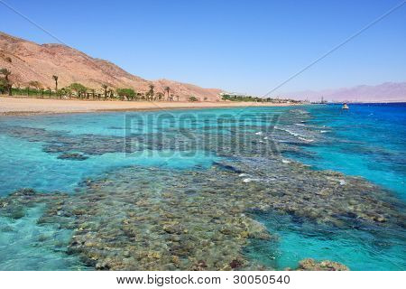 Horizontal oriented image of beautiful view on Red Sea and shoreline at popular touristic resort of Eilat, Israel.