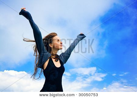 portrait of a young woman enjoying a freedom