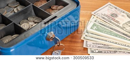 A Cash Box With Bills And Coins