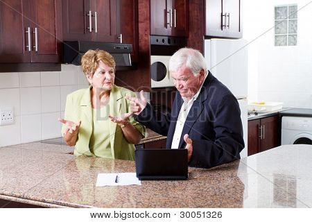 elderly couple having argument over expense