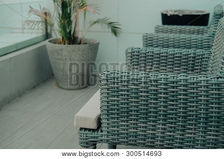 Brown Rattan Chair In Terrace Balcony. Living Design For Home Interior Design