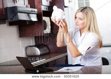 unhappy woman has no more money left to pay bills