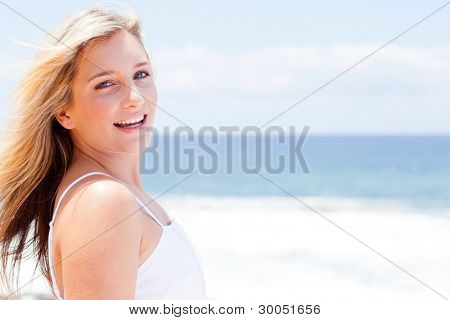 cheerful young woman smiling outdoors