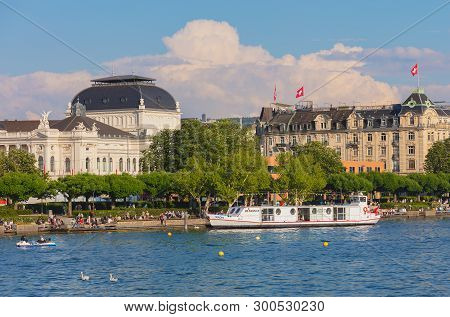 Zurich, Switzerland - May 11, 2018: People On The Embankment Of Lake Zurich In The City Of Zurich, Z