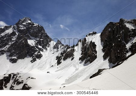 Snow Covered Sunlit Mountain Range With Traces From Avalanches In Sunny Winter Day. Turkey, Kachkar
