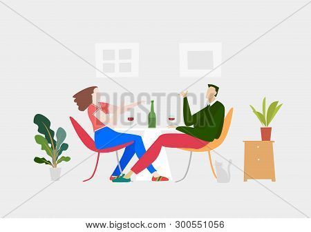 Young Couple Happily Chatting And Sharing The Bottle Of Vine. Everyday Life Concept