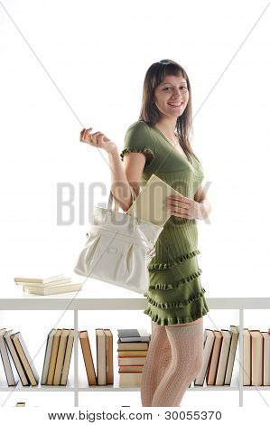 Attractive Young Woman With A Book In Her Bag
