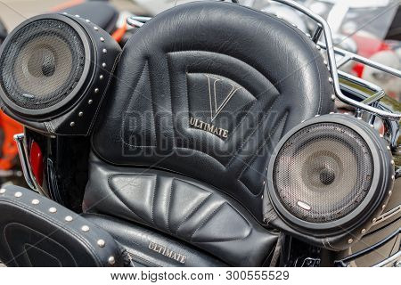 Moscow, Russia - May 04, 2019: Black Leather Seat With Inscription Ultimate And Sound System Speaker