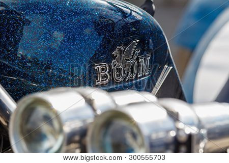 Moscow, Russia - May 04, 2019: Glossy Blue Fuel Tank With Emblem Of Boom Tourist Trike Closeup Again
