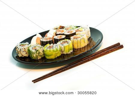 Sushi Set In A Black Plate With Chopsticks