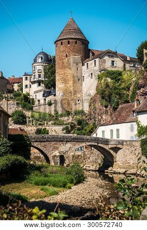 View From The Docks Of The Vaulted Bridge And The Old Medieval Town Of Semur En Auxois In France