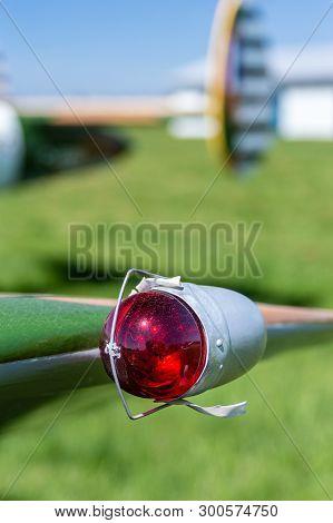 Red Vintage Left Side Aviation Navigation Light On Wing Tip.