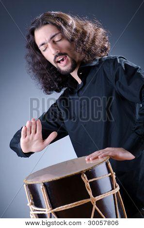 Man playing drum in studio