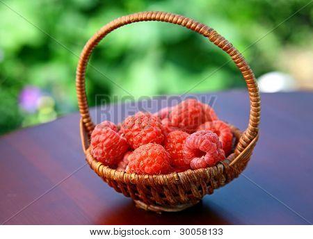Full Basket Of Red Raspberries On The Table