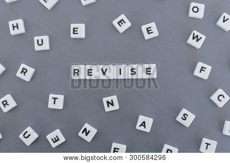 Revise Word Made Of Square Letter Word On Grey Background.