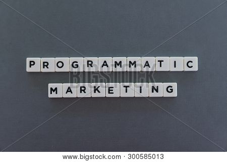 Programmatic Marketing Word Made Of Square Letter Word On Grey Background.