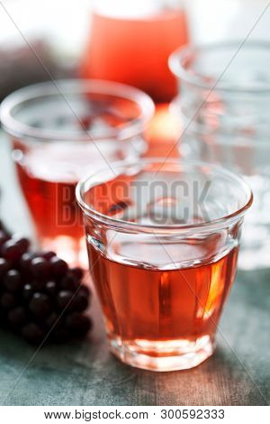 Rose wine served in small rustic glasses