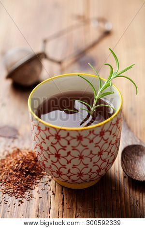 Rooibos tea with rosemary sprig
