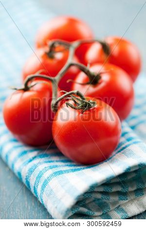 Fresh tomatoes on a kitchen towel