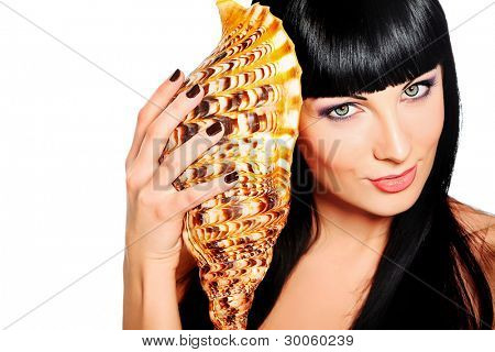Beautiful young woman posing with marine shell. Spa, healthcare. Isolated over white.