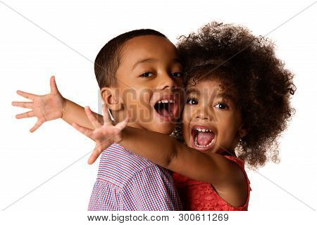 Two Cheerful African-american Siblings, Sister Hugging Her Brother, Isolated On White Background