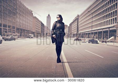 Elegant businesswoman on a city street