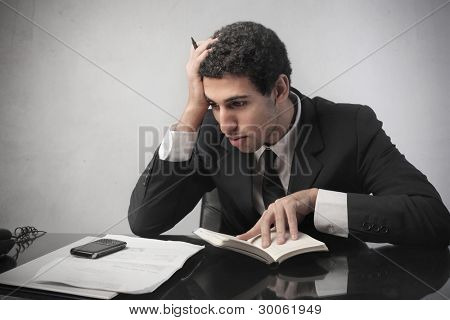 Stressed businessman making a financial plan