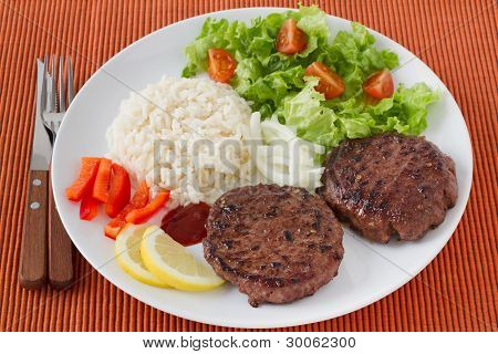 Grilled Hamburgers With Boiled Rice And Salad