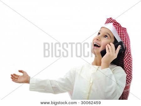 Arabic kid playing on phone in Ramadan