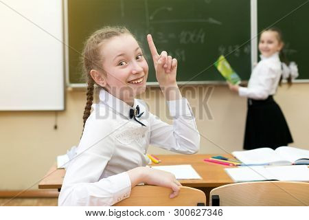 Girl Schoolgirl Rejoices That He Knows The Correct Answer To The Question. Invented A Brilliant Idea