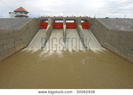 Water pouring through the water gates at dam landscape