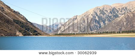 Panorama Landscape of mountain range at Lake Pearson Arthur's pass National Park New Zealand