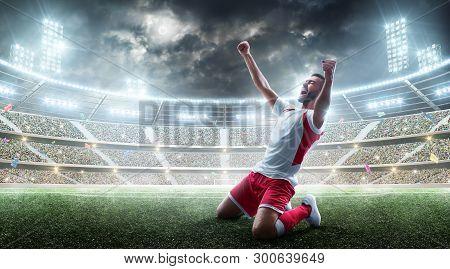 Soccer Wins. Professional Soccer Player Celebrates Winning The Open Stadium. Sport. 3d Stadium