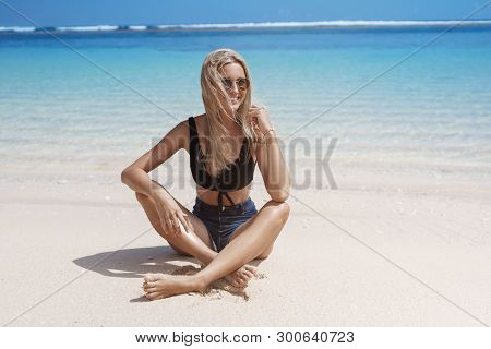 Travelling, Tourism, Holiday Concept. Attractive Happy Relaxed Tanned Blond European Woman Sit Sandy