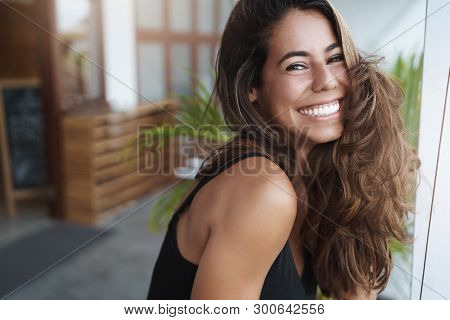 Wellbeing, Happiness, Beauty Concept. Joyful Grinning Attractive Tanned Woman White Teeth Smiling Ha