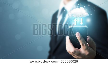 Cloud Computing And Technology Network Connection Concept. Businessman Hand Holding Mobile Smart Pho