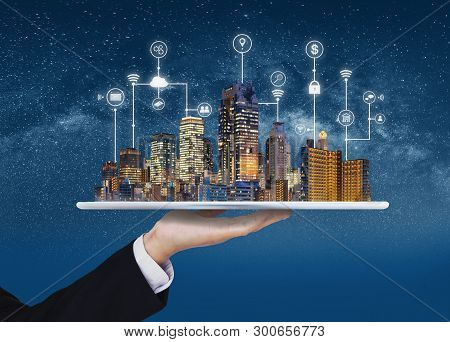 Smart City, Building Technology, And Real Estate Business. Businessman Holding Digital Tablet With B