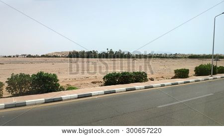 Road In The Sinai Desert, Sharm El Sheikh Road Through The City And The Desert. Urban Landscape In E