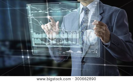 poster of Businessman holding a futuristic modern tablet touch screen analysing on investment risk managment and return on investment analysis