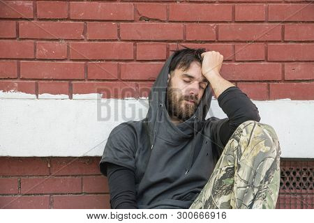Homeless Man Sleeping, Homeless Man Drug And Alcohol Addict Sitting Alone And Depressed On The Stree