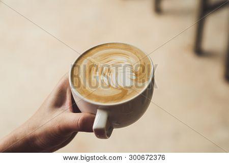 Closeup Image Of Female Barista Holding Latte Art Coffee