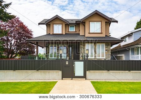Brand New Luxury Residential House For Sale. Big Family House With Concrete Pathway And Metal  Fence
