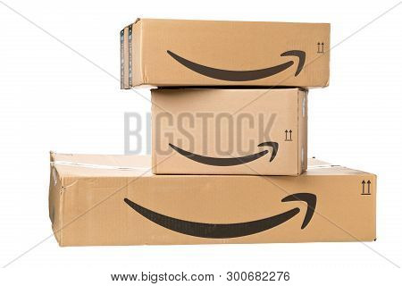 Dresden, Germany - April 3, 2019 : Amazon Logo On Stack Of Delivered Parcels Isolated On White Backg