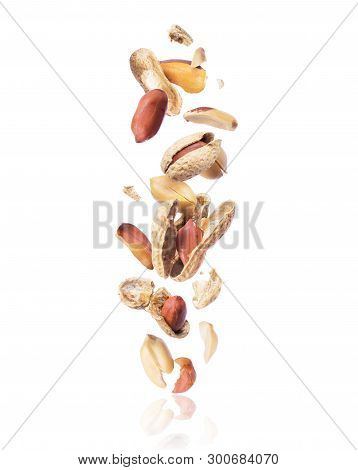 Cracked Peanuts Fall Down Isolated On White Background