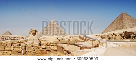 Panorama View Of Giza In Cairo, The Great Pyramyd Of Cheops, The Pyramids Of Kefren And Micerinos, T