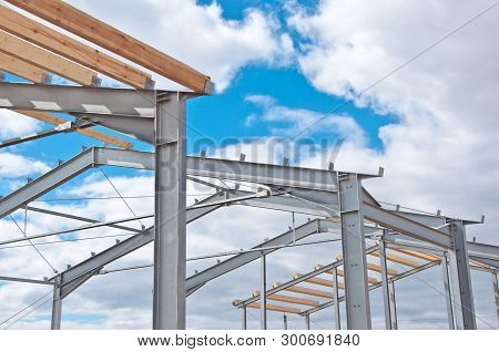 Metal Frame With Clouds Metal Frame For Building Insulation. Wood Beams And Metal Frame Of The New B